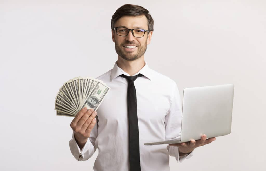 tech guy holding money