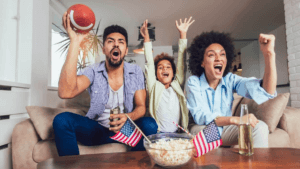 family on couch excited over football