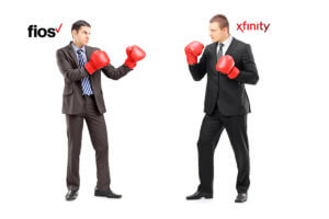 xfinity vs fios represented by boxers in suits