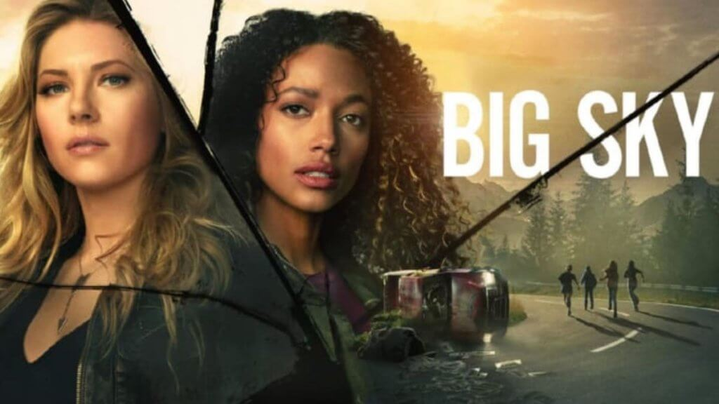 two women look at camera with big sky logo
