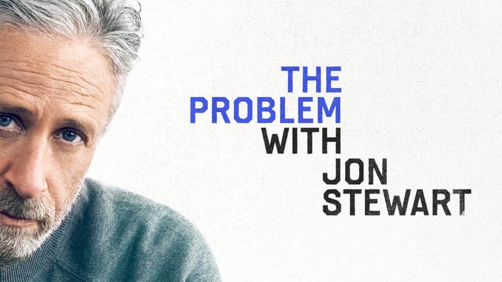 Jon Stewart looking at camera with show logo