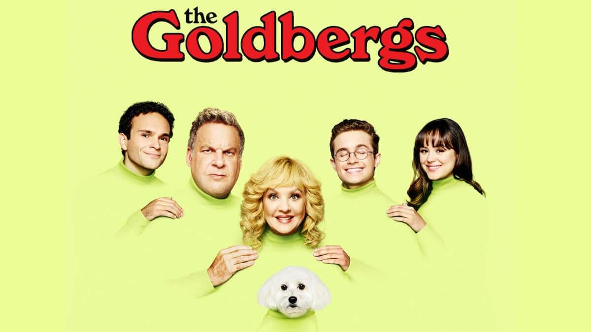 Show logo for The Goldbergs showing family photo with dog