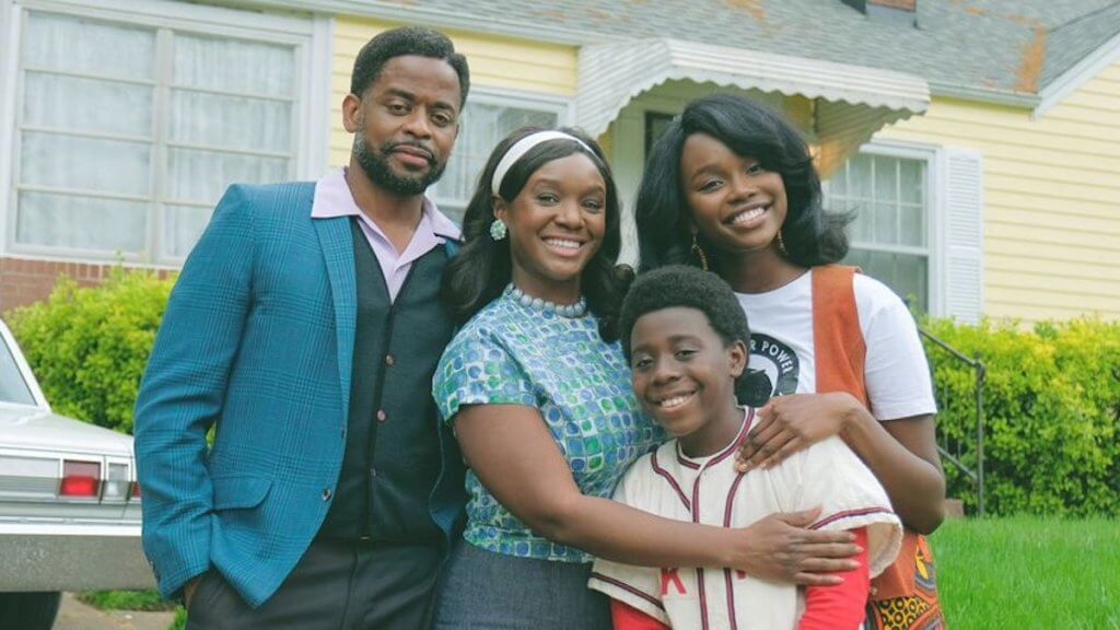 The cast of the wonder years, showing a family of Black actors in 1980s clothing facing the camera