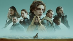 The cast of Dune over a silhouetted man walking across the desert