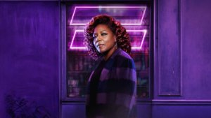 Female african american actor over purple neon equal sign