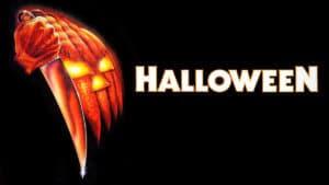 original poster art for Halloween movie featuring slashing pumpkin