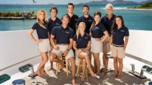 The cast/crew of Below Deck pictured on a boat deck