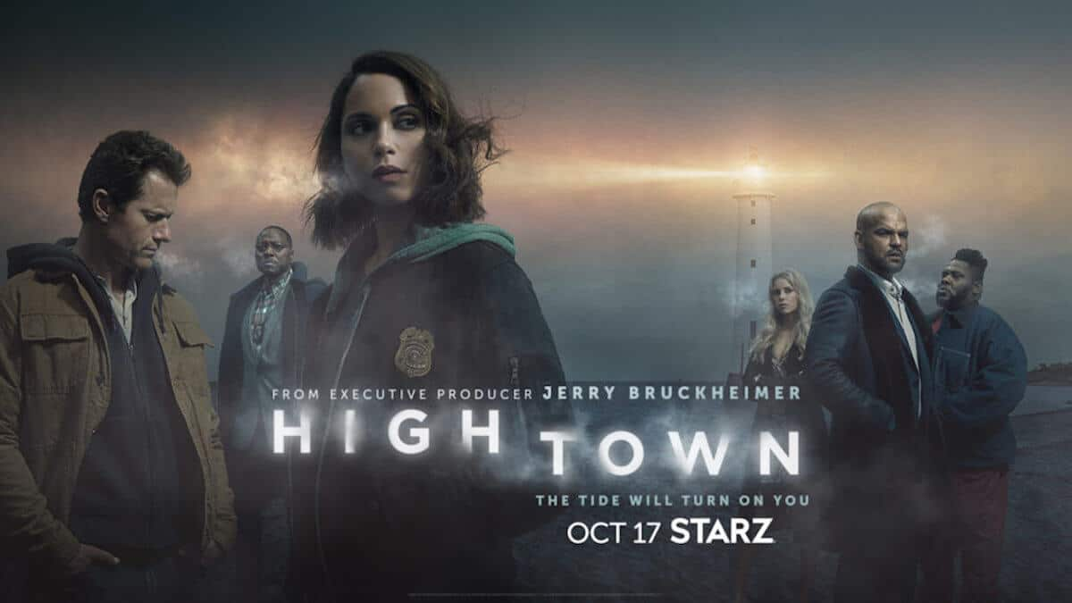 The cast of hightown in front of a foggy lighthouse