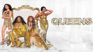 4 women in gold outfits on throne with Queens logo