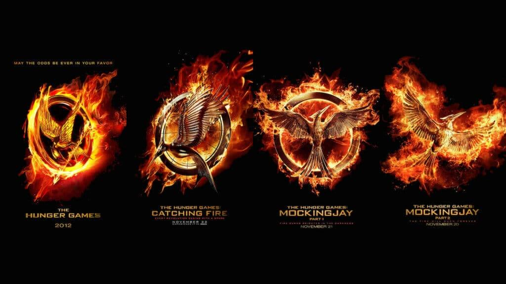 row of hunger games logo posters